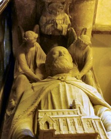 The alabaster memorial to William Leigh, holding a model of the church he built